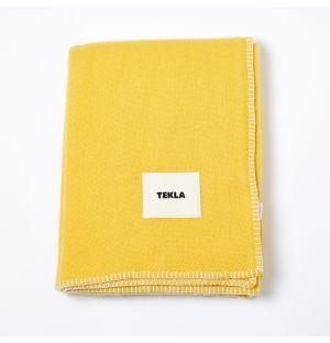 Couverture en laine jaune