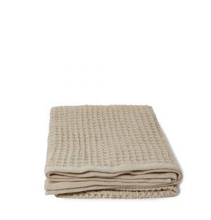 Serviette de bain en tissu gaufré beige