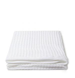 Serviette de bain en tissu gaufré blanc